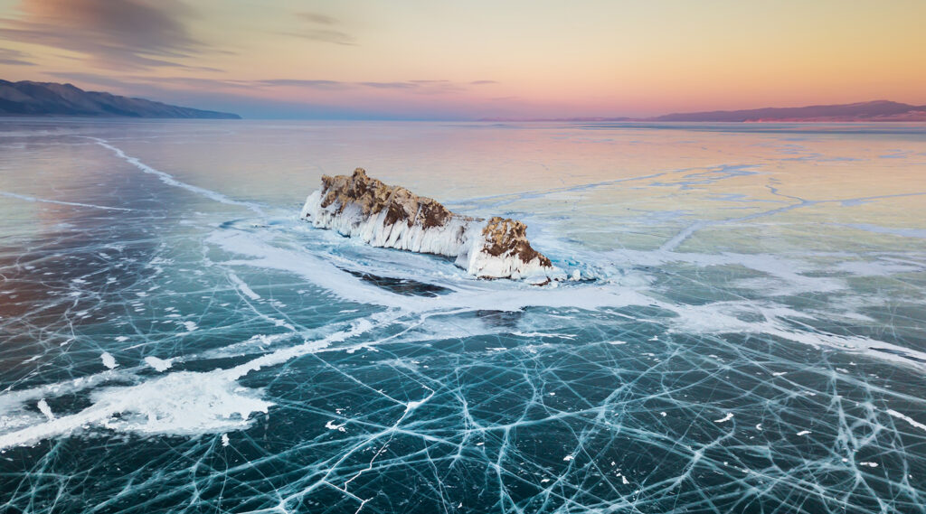 Elenka Island surrounded by the icy waters of Lake Baikal